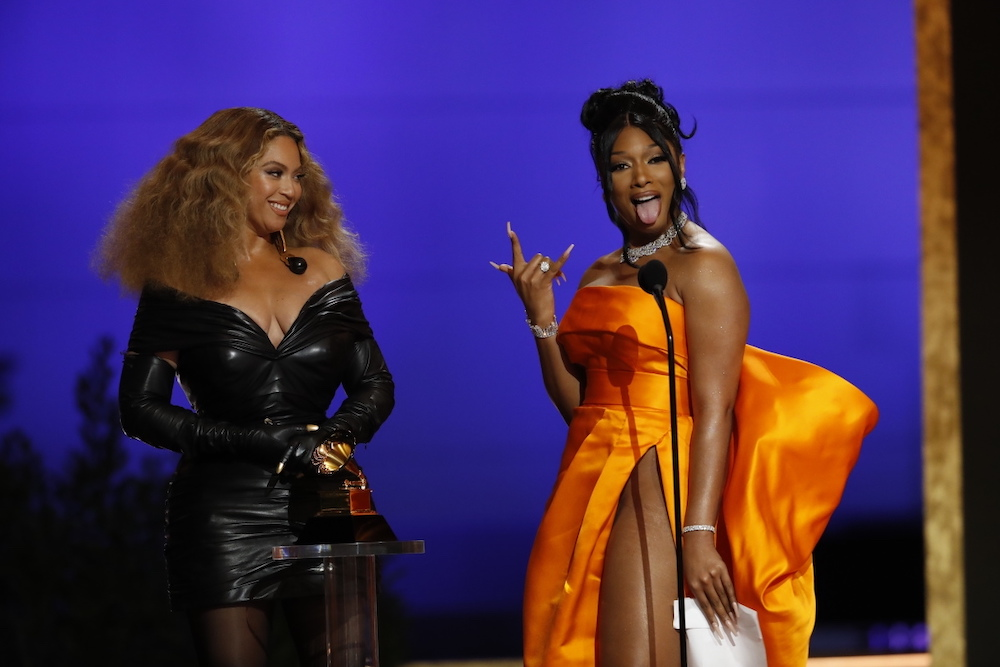 """Houston Hotties, Megan Thee Stallion, and Beyonce snagged Best Rap Song at the 63rd Annual Grammy Awards for """"Savage"""" (Remix) and we are all here for it!"""
