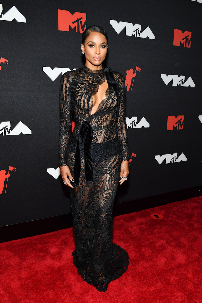 """Ciara stunned the red carpet in a lacy Tom Ford gown at last night's 2021 VMA's. The """"Level Up"""" singer made an appearance at the pop culture awards to introduce Normani ahead of her impressive performance for """"Wild Side""""."""